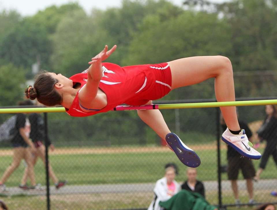 Faith Penny of East Islip clears the bar