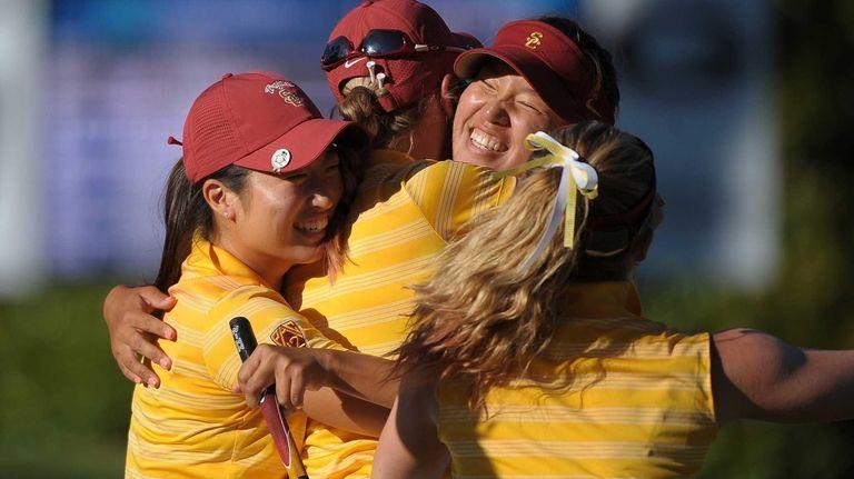 Southern California teammates swarm low-scorer Annie Park as