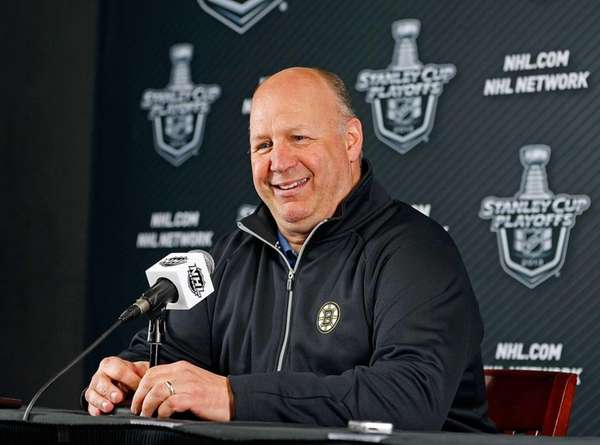 Boston Bruins head coach Claude Julien smiles during