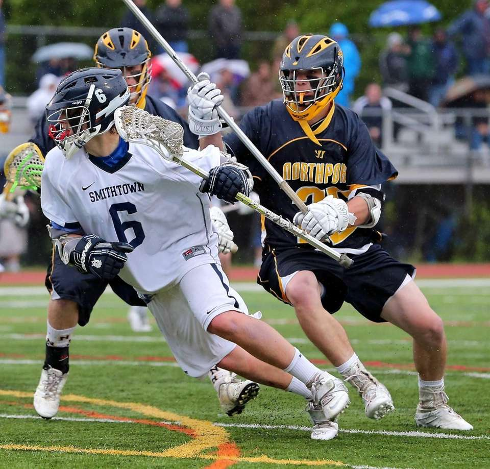 Smithtown West's Ryan Keenanmoves past two Northport defenders