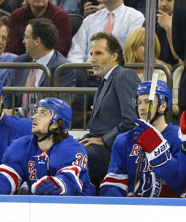 John Tortorella of the Rangers looks on from