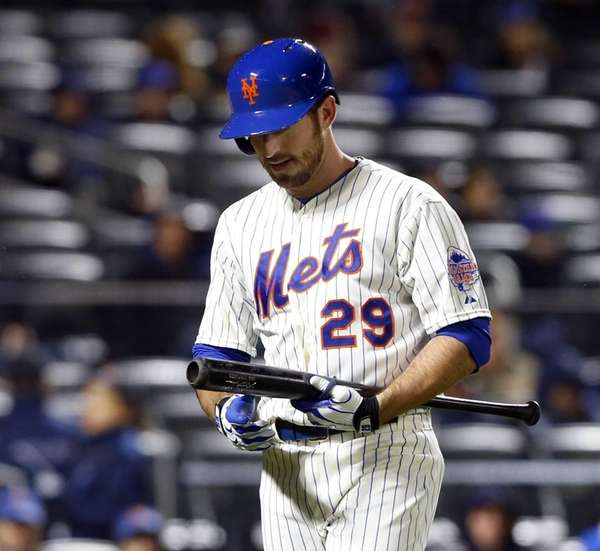 Ike Davis of the Mets walks back to