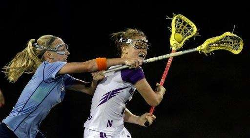 North Carolina's Laura Zimmerman, left, defends against Northwestern's