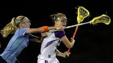 North Carolina's Laura Zimmerman, left, defends against Northwestern's
