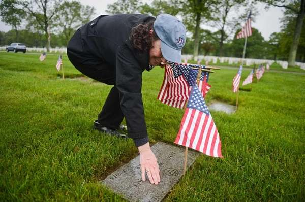 Colleen Jones, of Greenlawn, places her hand on