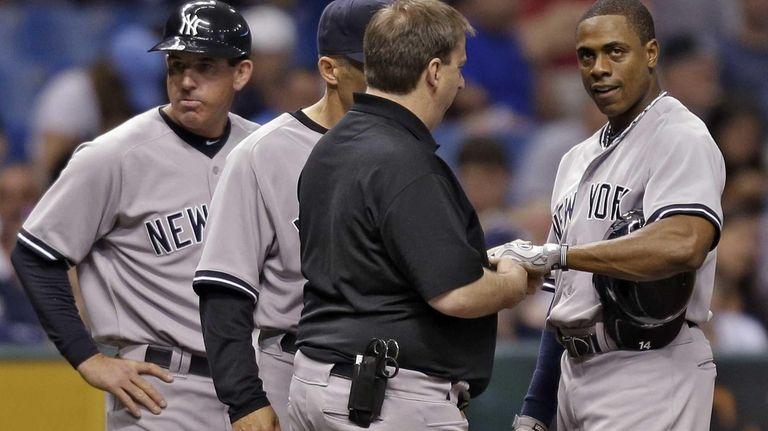 New York Yankees third base coach Rob Thomson,