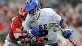 Duke's Greg DeLuca, right, drives past Cornell's Connor