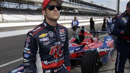 IndyCar driver Marco Andretti waits in the pit