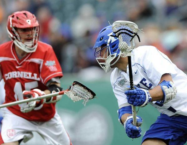 Duke's David Lawson, right, brings the ball past