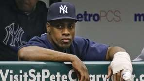 Yankees left fielder Curtis Granderson sits at the