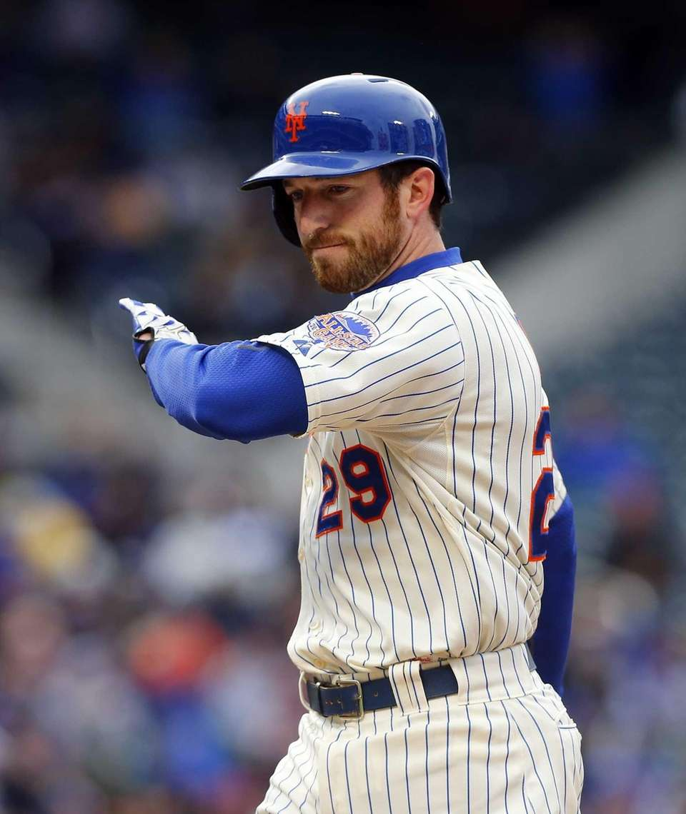 Ike Davis of the Mets follows through on