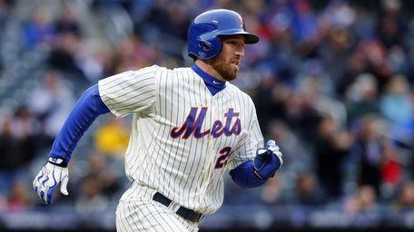 Ike Davis of the Mets follows through on