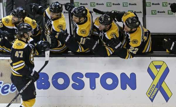 Boston Bruins defenseman Torey Krug is congratulated by