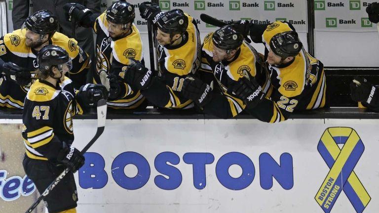 Boston Bruins defenseman Torey Krug is congratulated by