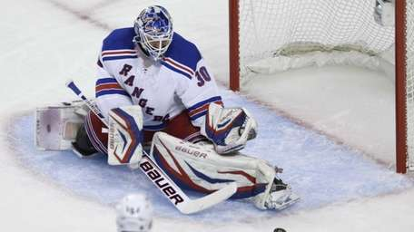 Rangers goalie Henrik Lundqvist makes a save against