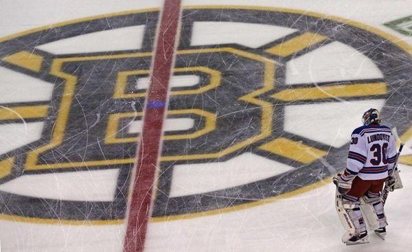 Rangers goalie Henrik Lundqvist skates across center ice