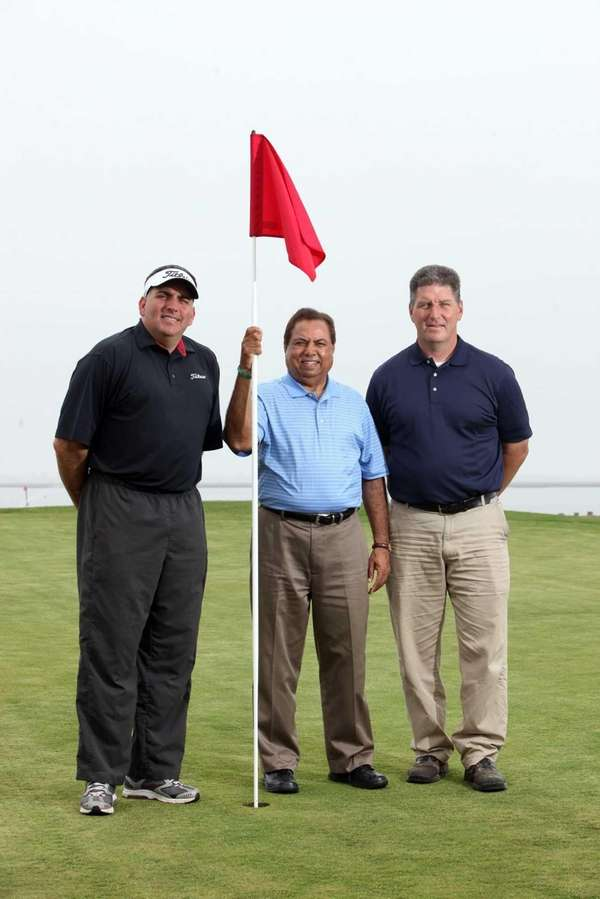 From left, head pro Ronnie Wright, owner Tariq