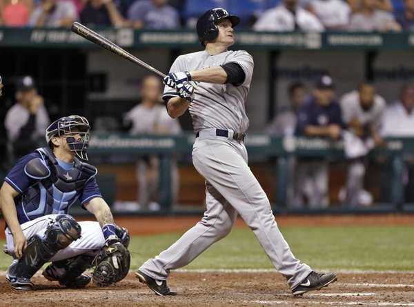 Yankees' Lyle Overbay, right, follows the flight of