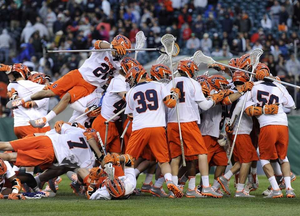 The Syracuse lacrosse team celebrates their 9-8 win