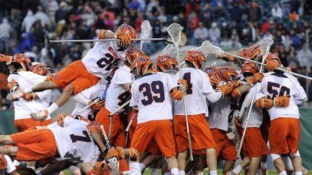 The Syracuse lacrosse team celebrates their 9-8 win