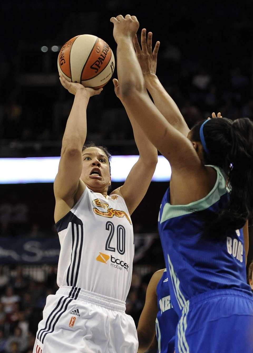 Connecticut Sun's Kara Lawson, left, shoots over Liberty's