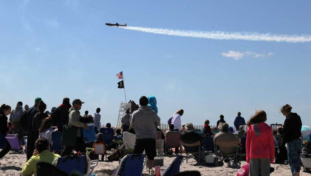 People watch the planes at the start of