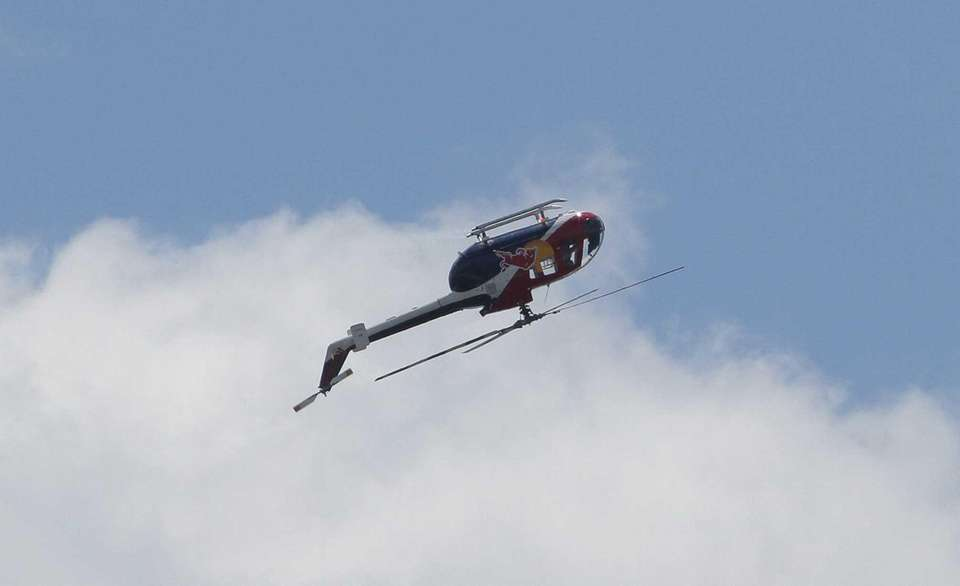 A helicopter performs stunts during the 2013 Bethpage