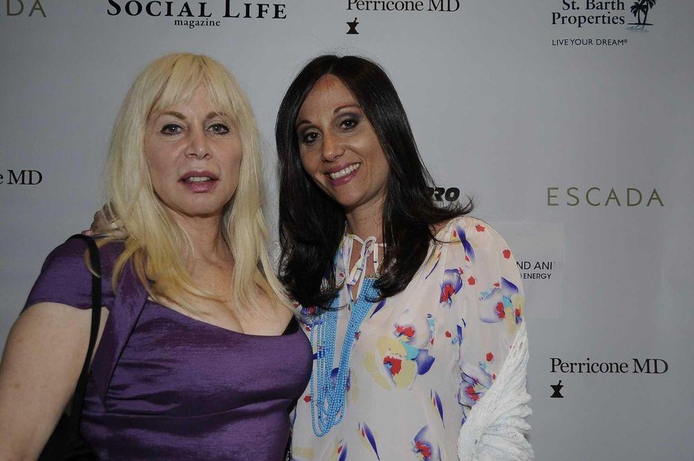 Liz Derringer, left, and Alison Terk attend the
