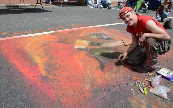 Volunteer firefighter Elijah Tyre, 22, of Riverhead, draws