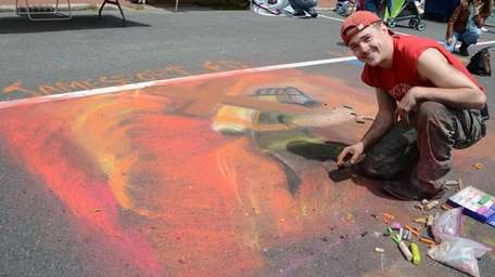 Volunteer firefighter Elijah Tyre, 22, of Riverhead, draws