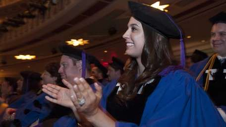 Meaghan Howard of Riverhead applauds during the Touro