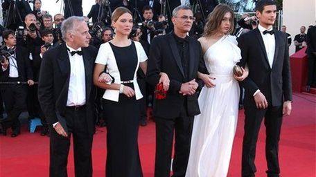From left, producer Brahim Chiqua, actress Lea Seydoux,