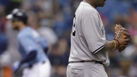 Yankees starting pitcher CC Sabathia reacts as James