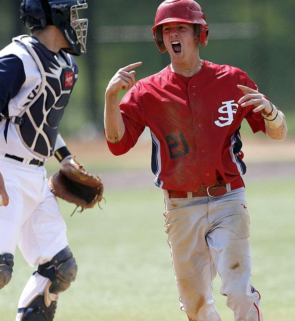 St. John the Baptist's Dylan Steigerwald celebrates after