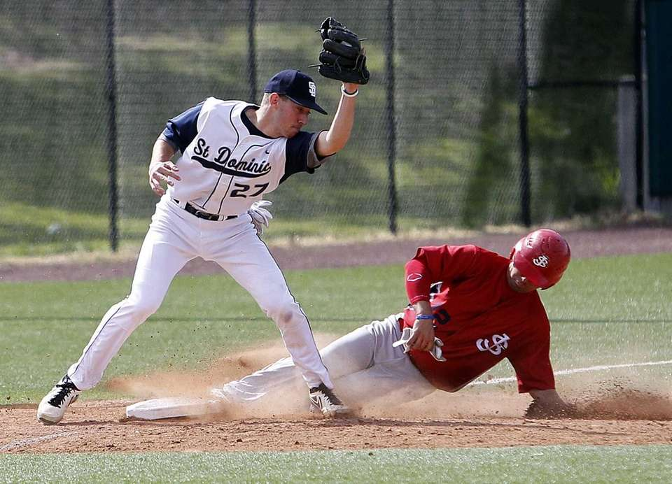 St. John the Baptist's Jonathan Tenaglia slides under
