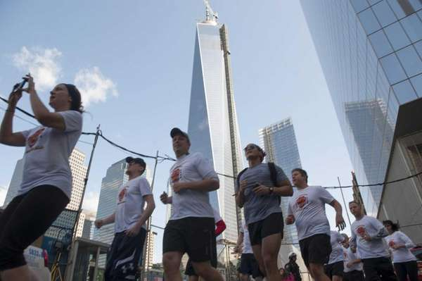 Runners, including former military service personal, finish a