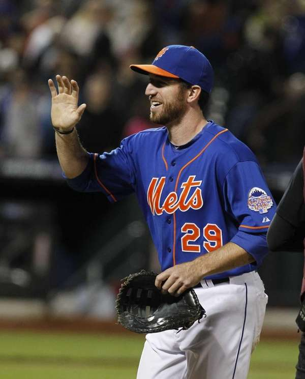 Ike Davis celebrates after the Mets beat the