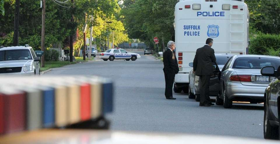 Suffolk County Police Homicide Squad detectives investigate the