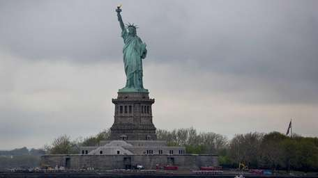 The Statue of Liberty is seen from a