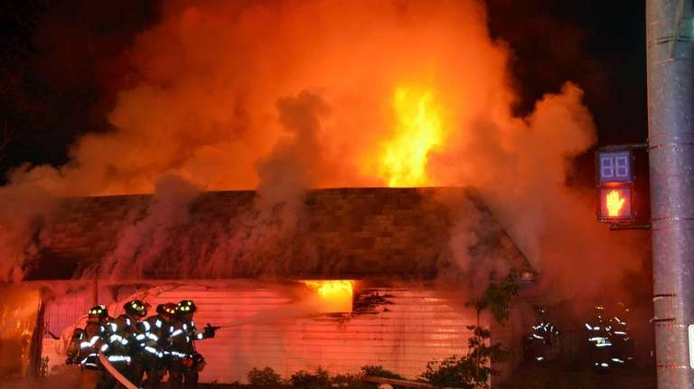 About 80 firefighters from three departments battled a