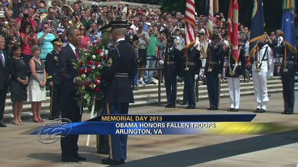 President Barack Obama places a wreath at the Tomb of the Unknowns at Arlington National Cemetery in Arlington, Va. on Memorial Day 2013.