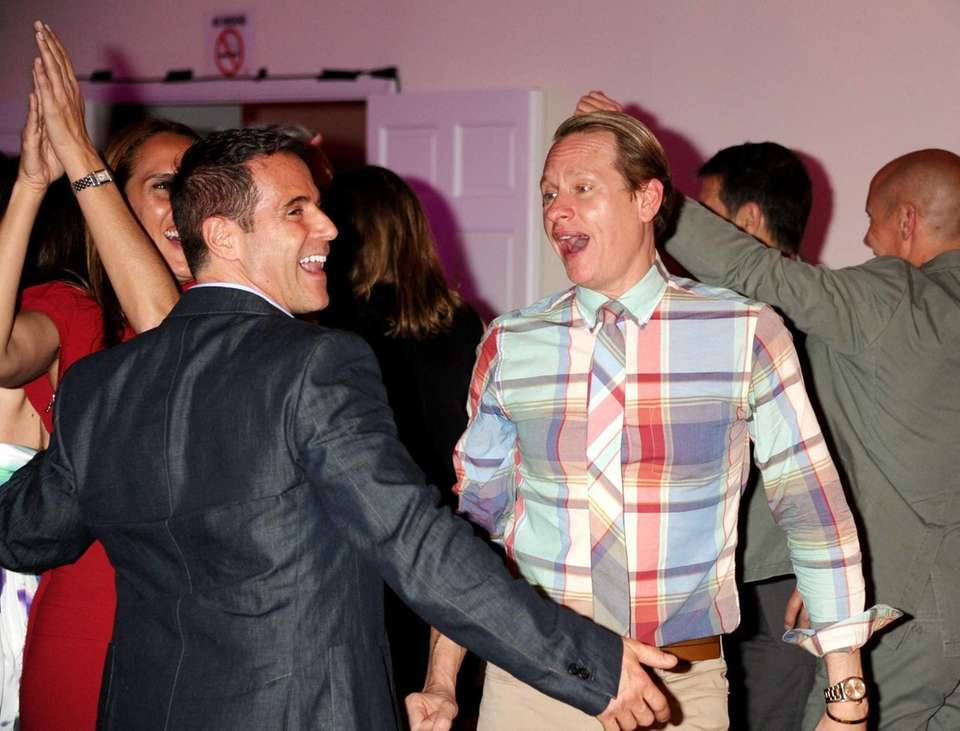Carson Kressley, right, dances up a storm at