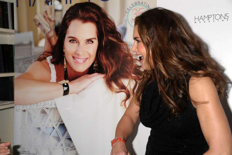 Brooke Shields admires her cover picture at the