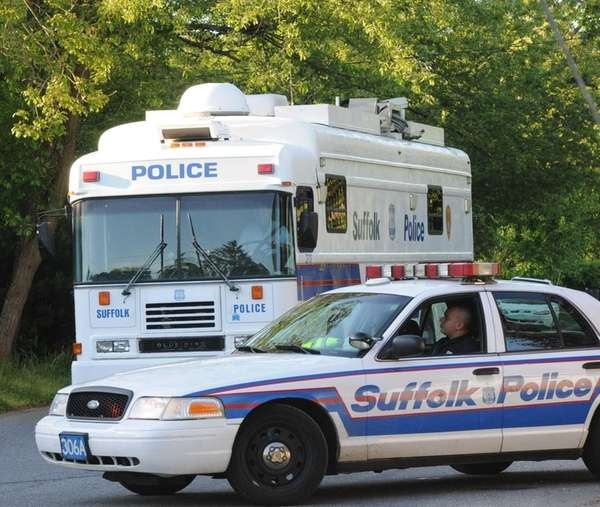 Suffolk County Police Homicide Squad detectives at the