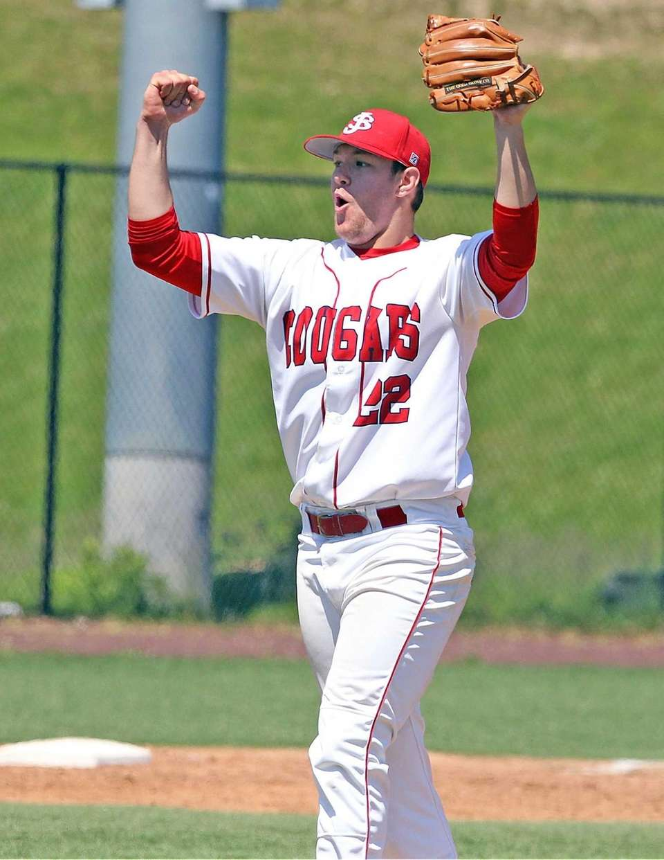 St. John the Baptist's pitcher Gregory Egan celebrates