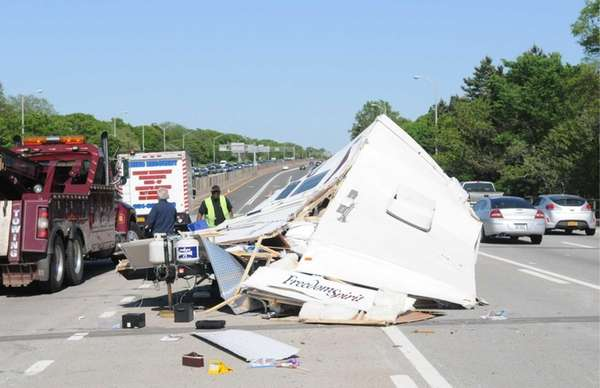 Scene of an overturned trailer and camper that