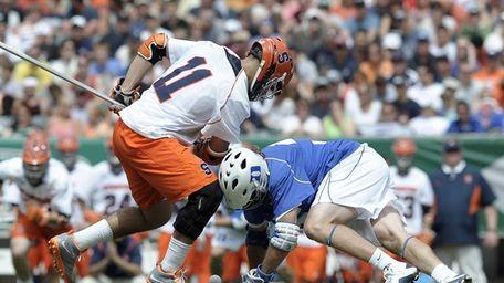Duke's Brendan Fowler, right, wins a face off