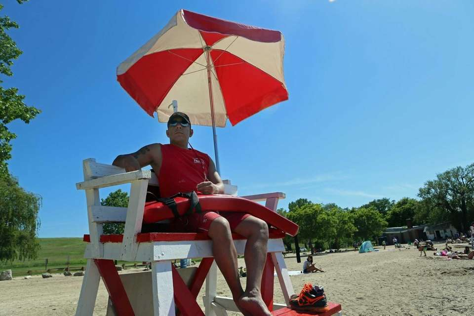Luis Donez keeps watch as beach-goers enjoyed the