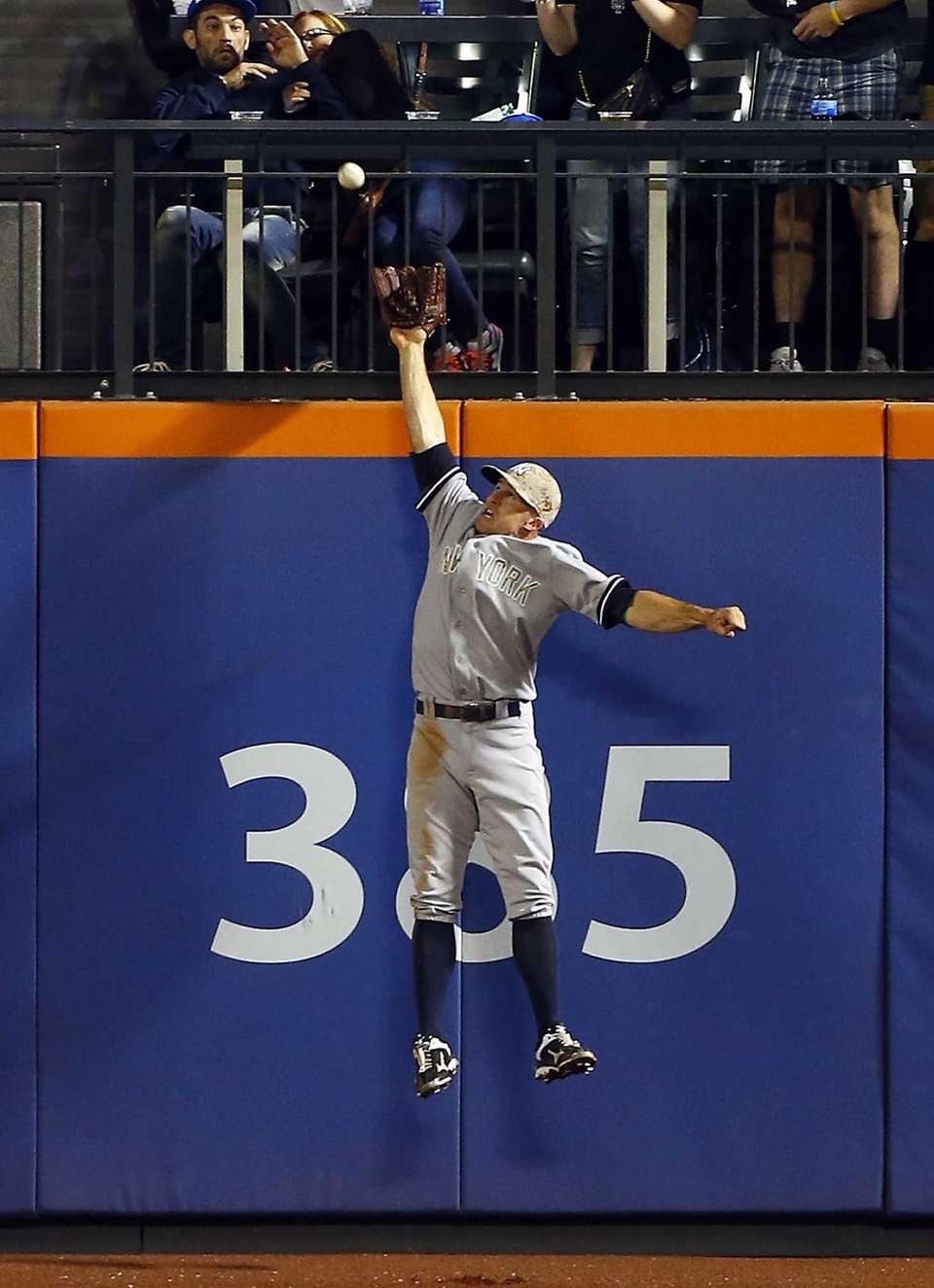 Brett Gardner leaps for the ball to rob