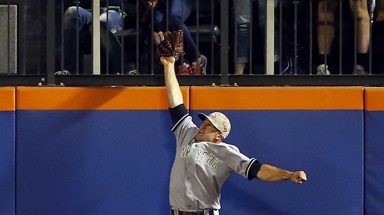 Brett Gardner leaps for the ball to rob